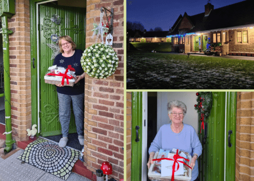 Residents with Christmas hampers